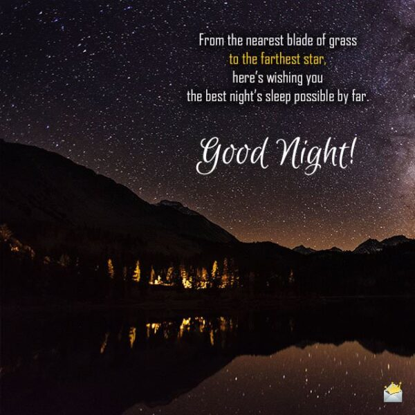 Good night quote on image of starry sky over a lake.