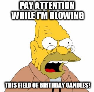 Pay attention while I m blowing this field of birthday candles!